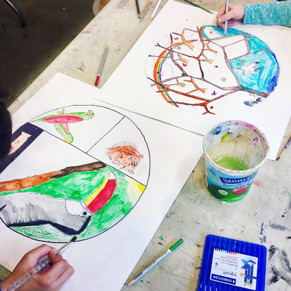 Students work on circle drawings of biomes