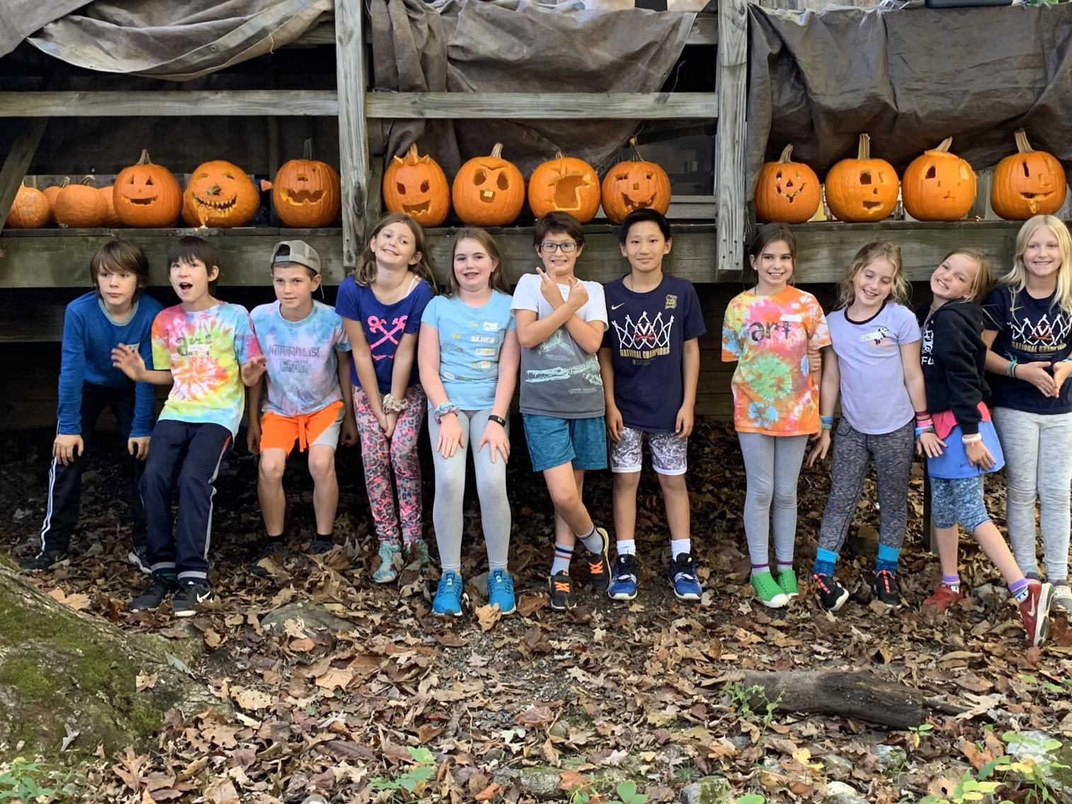 Students with their carved pumpkins