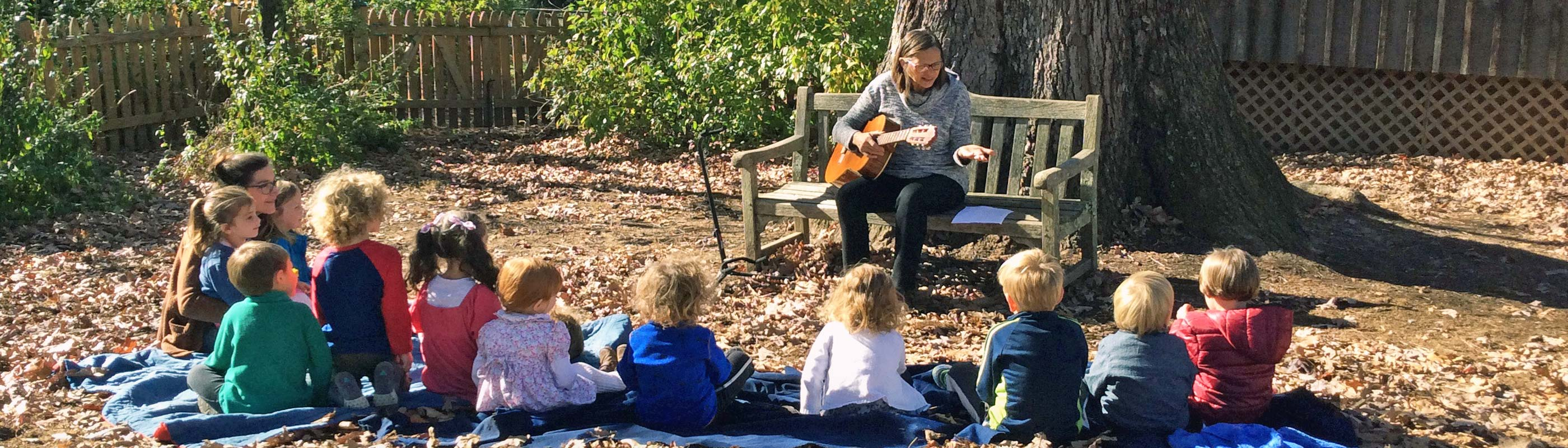 Marjo With Kids Outside Guitar